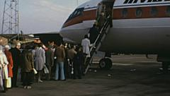 London 1970s: passengers entering into an Invicta charter at Luton airport Stock Footage