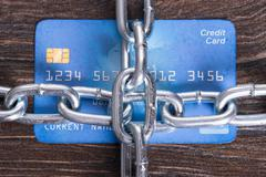 Chained credit card in secure payments concept Kuvituskuvat