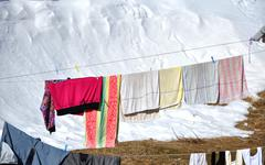 Hanging laundry drying on a clothesline at winter - stock photo