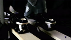 Skier attaching his ski boots, rear closing/opening of ski Stock Footage