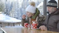 Senior couple enjoying hot chocolate Stock Footage