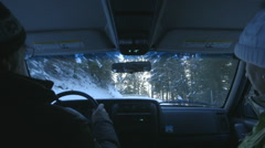 Driving through snow-covered road Stock Footage
