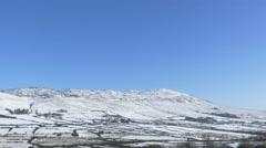 4k snow mountain, scenic winter background, sunny blue sky Stock Footage
