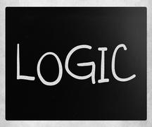 """Logic"" handwritten with white chalk on a blackboard - stock photo"
