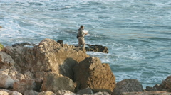 Fisherman on the rock - Tonel beach Stock Footage
