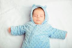Adorable little baby sleeping - stock photo