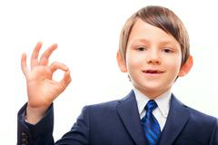 Business child in suit and tie posing - stock photo