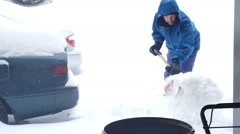Man shoveling snow winter Stock Footage