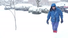 man walking in snow  2 - stock footage