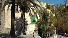 Spain Mallorca Island mountain village Montuiri 010 palm trees on church yard Stock Footage