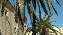 Spain Mallorca Island mountain village Montuiri 011 Palm trees on church yard. Stock Footage