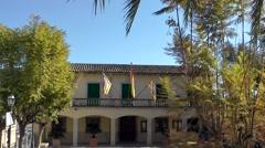 Spain Mallorca Island mountain village Montuiri 008 small town hall with flags Stock Footage