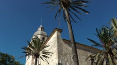 Spain Mallorca Island mountain village Montuiri 004 Spanish church and palms Stock Footage