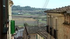 Spain Mallorca Island mountain village Montuiri 002 farming fields behind roofs Stock Footage