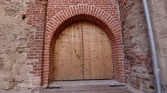 Medieval castles wooden door, tilt up Stock Footage