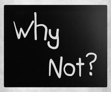 """Why Not?"" handwritten with white chalk on a blackboard - stock photo"