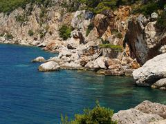 Severe rusty  rocky  coast of adriatic sea Stock Photos