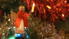 4k christmas decoration, angel, tinsel and lights - stock footage