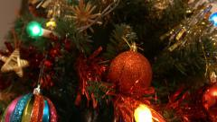 4k pan down on beautiful christmas tree with decorations, lights and tinsel - stock footage