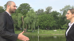 Business people, man and woman meeting in the park, gender equality, shake hands Stock Footage