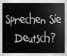 """""""Sprechen sie Deutsch"""" handwritten with white chalk on a blackbo Stock Photos"""