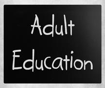 """""""Adult Education"""" handwritten with white chalk on a blackboard - stock photo"""