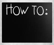 """How To"" handwritten with white chalk on a blackboard Stock Photos"