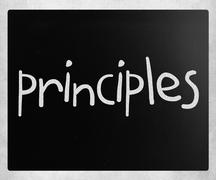 """Stock Photo of """"Principles"""" handwritten with white chalk on a blackboard"""