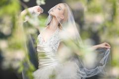 Close up of dreamy beautiful blonde bride - stock photo