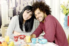 Stock Photo of Smiling couple during breakfast at home