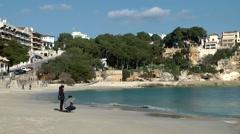 Spain Mallorca Island small town Porto Cristo 010 couple on empty beach Stock Footage