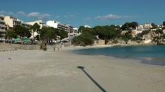 Spain Mallorca Island small town Porto Cristo 009 flag mast shadow in the sand Stock Footage