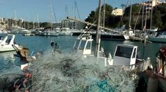 Spain Mallorca Island small town Porto Cristo 008 fishing nets and boats Stock Footage