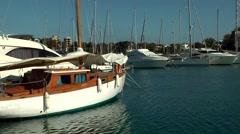Spain Mallorca Island small town Porto Cristo 003 sailing boats in blue water Stock Footage