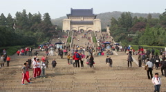 Tourists walking on the stone steps to Dr. Sun Yat-sen's Mausoleum Stock Footage