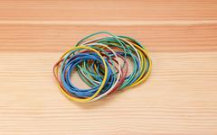 Small pile of coloured elastic bands - stock photo