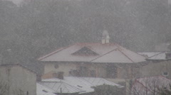 Stock Video Footage of Mountain landscape, snow falling in abundance over houses, winter smoky chimney