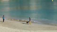 Spain Mallorca Island small town Porto Cristo 016 guys with a dog at the beach Stock Footage