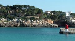 Spain Mallorca Island small town Porto Cristo 013 rocky headland with houses Stock Footage