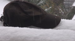 Stock Video Footage of Nice color contrast, black cap and white snow, winter snow fall in abundance