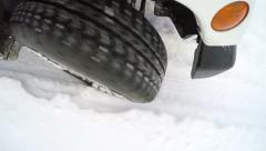 4K Jeep tire driving through deep powder snow Stock Footage