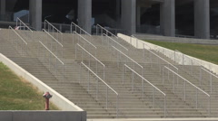 Wide stairway for entry to new football stadium, massive building columns view Stock Footage