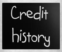 """""""Credit history"""" handwritten with white chalk on a blackboard Stock Photos"""