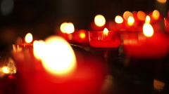 Red votive candles close up. Stock Footage
