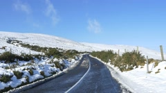 4k deserted road across snow mountain, sunny day, adventure ahead, new begining Stock Footage