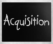 "The word ""Acquisition"" handwritten with white chalk on a blackbo - stock photo"