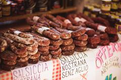 Stock Photo of salami and sausages sold in the stall at an outdoor market Italy