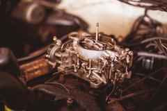 Used carburetor from the fuel supply system of gasoline engine Stock Photos