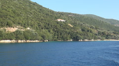 Landscape with Ionian island seashore seen from a boat trip in a summer day. - stock footage