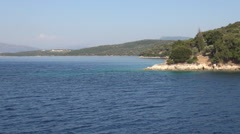 Landscape with Skorpios island seashore seen from a boat trip in a summer day. Stock Footage